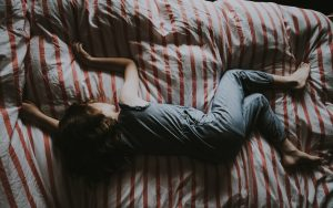 Girl lay in bed